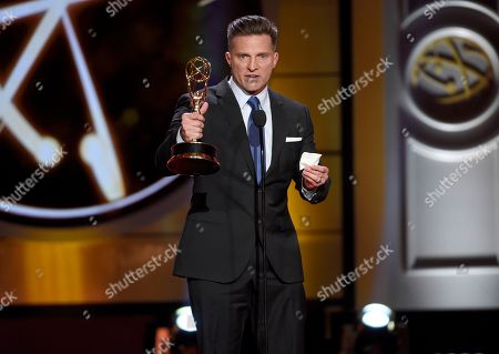 """Steve Burton accepts the award for supporting actor in a drama series for """"The Young and the Restless"""" at the 44th annual Daytime Emmy Awards at the Pasadena Civic Center, in Pasadena, Calif"""