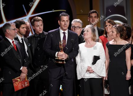 "Frank Valentini, center, and the cast and crew of ""General Hospital"" accept the award for outstanding drama series at the 44th annual Daytime Emmy Awards at the Pasadena Civic Center, in Pasadena, Calif"