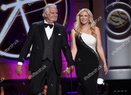 Stock Image of John McCook, left, and Katherine Kelly Lang walk on stage at the 44th annual Daytime Emmy Awards at the Pasadena Civic Center, in Pasadena, Calif
