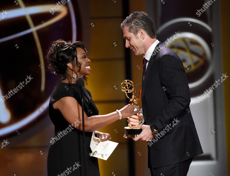 "Stock Picture of Gladys Knight, left, presents Frank Valentini with the award for outstanding drama series directing team for ""General Hospital"" at the 44th annual Daytime Emmy Awards at the Pasadena Civic Center, in Pasadena, Calif"