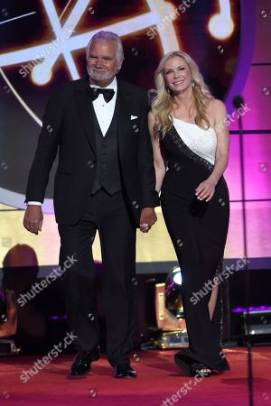 John McCook, left, and Katherine Kelly Lang walk on stage at the 44th annual Daytime Emmy Awards at the Pasadena Civic Center, in Pasadena, Calif