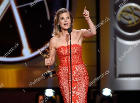 """Stock Photo of Gina Tognoni accepts the award for outstanding lead actress in a drama series for """"The Young and the Restless"""" at the 44th annual Daytime Emmy Awards at the Pasadena Civic Center, in Pasadena, Calif"""