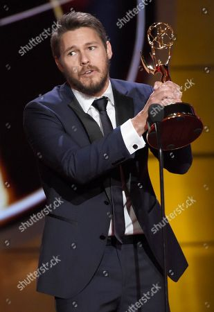 """Stock Photo of Scott Clifton accepts the award for outstanding lead actor in a drama series for """"The Bold and the Beautiful"""" at the 44th annual Daytime Emmy Awards at the Pasadena Civic Center, in Pasadena, Calif"""