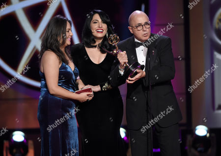 """Natali Monterrosa, from left, Alejandra Oraa, and Eduardo Suarez accept the award for outstanding entertainment program in Spanish language program for """"Destinos"""" at the 44th annual Daytime Emmy Awards at the Pasadena Civic Center, in Pasadena, Calif"""
