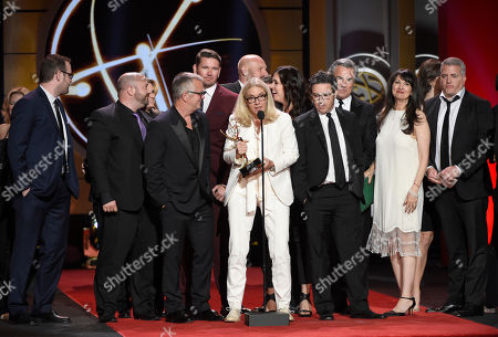 """Stock Picture of Mary Connelly, center, accepts the award for outstanding entertainment talk show for """"The Ellen DeGeneres Show"""" at the 44th annual Daytime Emmy Awards at the Pasadena Civic Center, in Pasadena, Calif"""