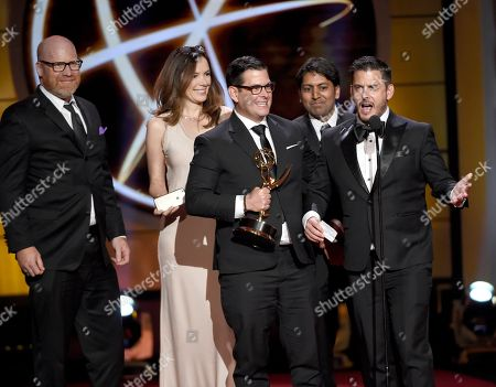 """Bill Pruitt, from left, Paulina Williams, Mike Duffy, Rajan Shandil, and Tim Duffy accept the award for outstanding culinary program for """"Eat the World with Emeril Lagasse"""" at the 44th annual Daytime Emmy Awards at the Pasadena Civic Center, in Pasadena, Calif"""