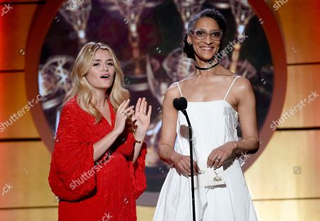 Daphne Oz, left, and Carla Hall present the award for outstanding supporting actress in a drama series at the 44th annual Daytime Emmy Awards at the Pasadena Civic Center, in Pasadena, Calif