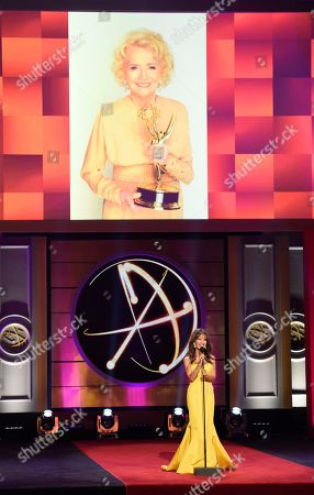 Stock Photo of Susan Lucci speaks on stage in tribute to Agnes Nixon at the 44th annual Daytime Emmy Awards at the Pasadena Civic Center, in Pasadena, Calif