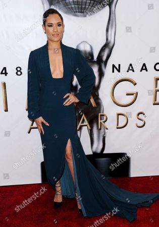 Grace Byers arrives at the 48th annual NAACP Image Awards at the Pasadena Civic Auditorium, in Pasadena, Calif
