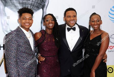 Stock Photo of Nathan Anderson, from left, Alvina Stewart, Anthony Anderson, and Kyra Anderson arrive at the 48th annual NAACP Image Awards at the Pasadena Civic Auditorium, in Pasadena, Calif