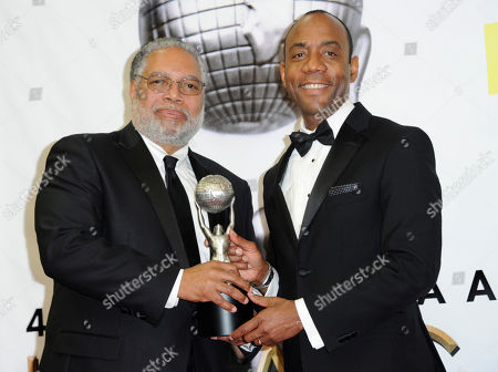 Dr. Lonnie G. Bunch III, left, and NAACP President Cornell William Brooks pose with the president's award in the press room at the 48th annual NAACP Image Awards at the Pasadena Civic Auditorium, in Pasadena, Calif