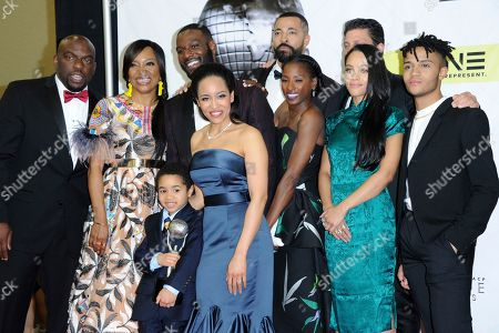 "Omar J. Dorsey, from left, Tina Lifford, Ethan Hutchison, Kofi Siriboe,Timon Kyle Durrett, Rutina Wesley, Bianca Lawson, Greg Vaughan and Nicholas L. Ashe pose in the pressroom with the award for outstanding drama for ""Queen Sugar"" at the 48th annual NAACP Image Awards at the Pasadena Civic Auditorium, in Pasadena, Calif"