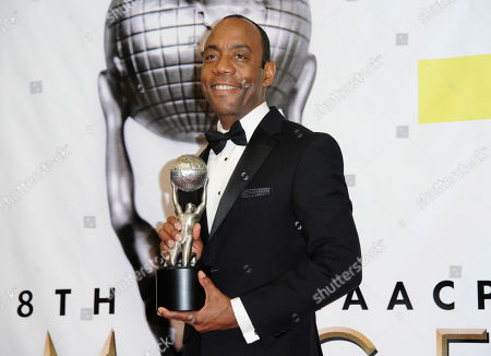 NAACP President Cornell William Brooks poses in the press room with the president's award after presenting it to Dr. Lonnie G. Bunch III at the 48th annual NAACP Image Awards at the Pasadena Civic Auditorium, in Pasadena, Calif