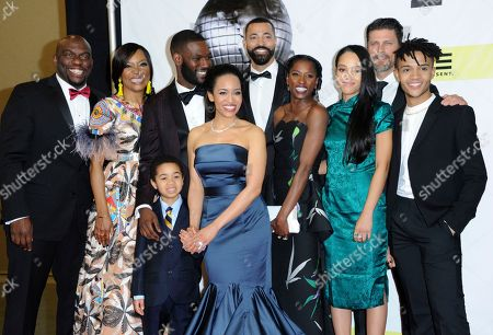 "Omar J. Dorsey, from left, Tina Lifford, Ethan Hutchison, Kofi Siriboe, Timon Kyle Durrett, Rutina Wesley, Bianca Lawson, Greg Vaughan and Nicholas L. Ashe pose in the press room with the award for outstanding drama for ""Queen Sugar"" at the 48th annual NAACP Image Awards at the Pasadena Civic Auditorium, in Pasadena, Calif"