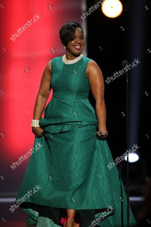 NAACP Chairman Roslyn M. Brock presents the chairman's award at the 48th annual NAACP Image Awards at the Pasadena Civic Auditorium, in Pasadena, Calif