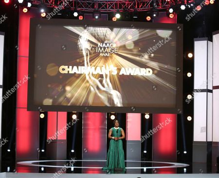 Stock Photo of NAACP Chairman Roslyn M. Brock presents the chairman's award at the 48th annual NAACP Image Awards at the Pasadena Civic Auditorium, in Pasadena, Calif