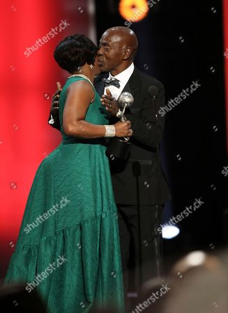 NAACP Chairman Roslyn M. Brock, left, presents the chairman's award to professor Charles J. Ogletree at the 48th annual NAACP Image Awards at the Pasadena Civic Auditorium, in Pasadena, Calif