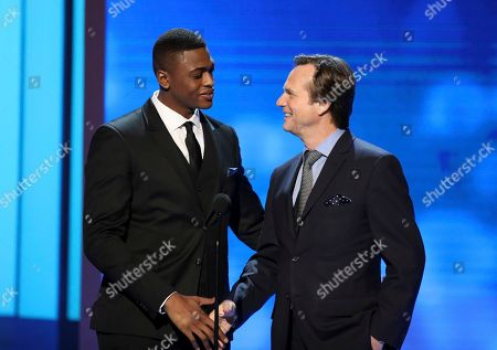 Stock Photo of Justin Cornwell, left, and Bill Paxton present the award for outstanding actress in a motion picture at the 48th annual NAACP Image Awards at the Pasadena Civic Auditorium, in Pasadena, Calif