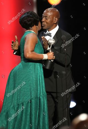 NAACP Chairman Roslyn M. Brock, left, presents the chairman's award to professor Charles J. Ogletree Jr. at the 48th annual NAACP Image Awards at the Pasadena Civic Auditorium, in Pasadena, Calif