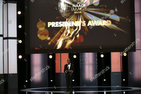 NAACP President Cornell William Brooks presents the president's award at the 48th annual NAACP Image Awards at the Pasadena Civic Auditorium, in Pasadena, Calif