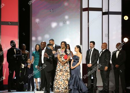 """Omar J. Dorsey, center left, and the cast and crew of """"Queen Sugar"""" accept the award for outstanding drama series at the 48th annual NAACP Image Awards at the Pasadena Civic Auditorium, in Pasadena, Calif"""
