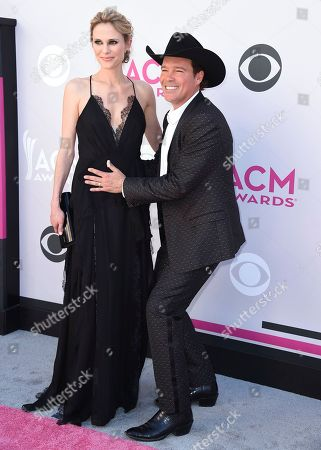 Stock Photo of Jessica Craig, left, and Clay Walker arrive at the 52nd annual Academy of Country Music Awards at the T-Mobile Arena, in Las Vegas