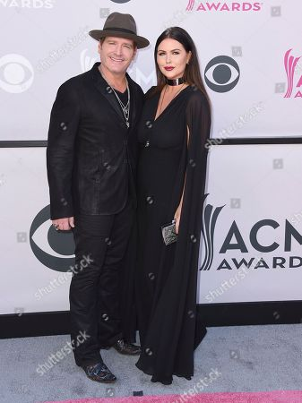 Jerrod Niemann, left, and Morgan Petek arrive at the 52nd annual Academy of Country Music Awards at the T-Mobile Arena, in Las Vegas