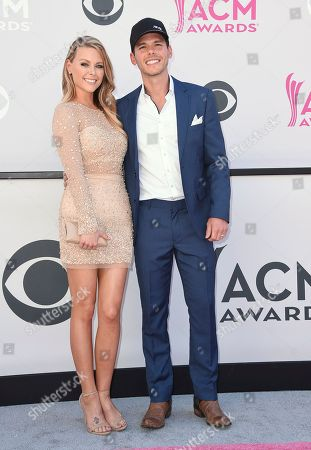 Amber Bartlett, left, and Granger Smith arrive at the 52nd annual Academy of Country Music Awards at the T-Mobile Arena, in Las Vegas