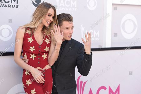 Christina Murphy, left, and Frankie Ballard show off their wedding rings at the 52nd annual Academy of Country Music Awards at the T-Mobile Arena, in Las Vegas