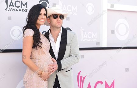 Justin Moore, right, and Kate Moore arrive at the 52nd annual Academy of Country Music Awards at the T-Mobile Arena, in Las Vegas