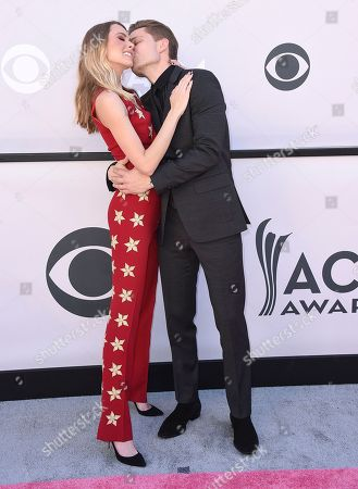 Christina Murphy, left, and Frankie Ballard kiss at the 52nd annual Academy of Country Music Awards at the T-Mobile Arena, in Las Vegas