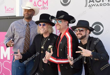 Cowboy Troy, from left, Big Kenny and John Rich, of Big & Rich, and DJ Sinister arrive at the 52nd annual Academy of Country Music Awards at the T-Mobile Arena, in Las Vegas