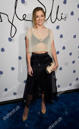 Actress Lili Simmons poses at the fifth anniversary of designer Tyler Ellis' eponymous accessories line at the Chateau Marmont, in West Hollywood, Calif