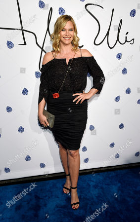 Actress Natasha Henstridge poses at the fifth anniversary of designer Tyler Ellis' eponymous accessories line at the Chateau Marmont, in West Hollywood, Calif