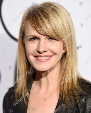 Actress Kathryn Morris poses at the fifth anniversary of designer Tyler Ellis' eponymous accessories line at the Chateau Marmont, in West Hollywood, Calif