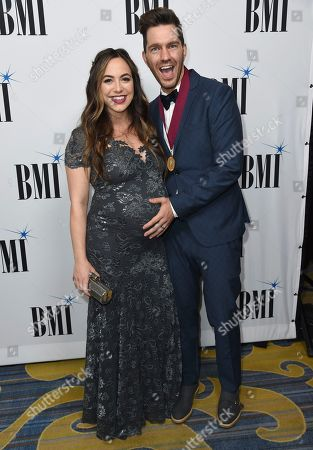 Aijia Lise, left, and Andy Grammer arrive at the 65th annual BMI Pop Awards at the Beverly Wilshire Hotel, in Beverly Hills, Calif