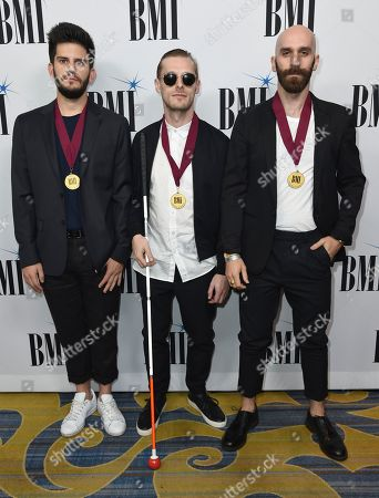 BMI Award winners, Adam Levin, from left, Casey Harris and Sam Harris, of X Ambassadors, arrive at the 65th annual BMI Pop Awards at the Beverly Wilshire Hotel, in Beverly Hills, Calif