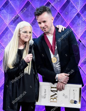 """Barbara Cane, VP and general manager, writer/public relations, BMI, left, presents the BMI award to Ricky Reed for """"No"""" at the 65th annual BMI Pop Awards at the Beverly Wilshire Hotel, in Beverly Hills, Calif"""