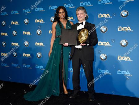 "Steven Zaillian, right, director of the ""The Night Of"" episode ""The Beach,"" poses backstage with presenter Laverne Cox after winning the Movies for Television and Mini-Series award at the 69th Annual Directors Guild of America Awards at the Beverly Hilton, in Beverly Hills, Calif"