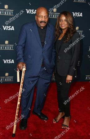 Former NFL player Jim Brown, left, and Monique Brown arrives at the 6th annual NFL Honors at the Wortham Center, in Houston
