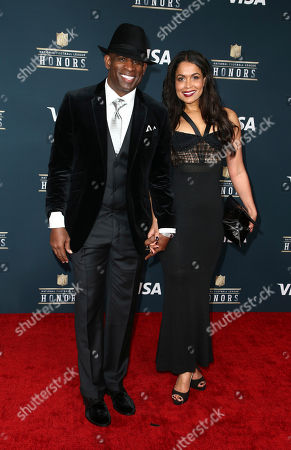 Former NFL player Deion Sanders, left, and Tracey Edmonds arrive at the 6th annual NFL Honors at the Wortham Center, in Houston