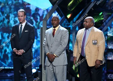 Stock Photo of Former NFL players Peyton Manning, from left, Derrick Brooks and Willie Lanier appear on stage at the 6th annual NFL Honors at the Wortham Center, in Houston