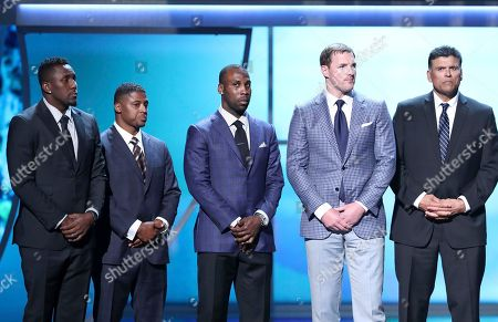 Former NFL players Thomas Davis, from left, Warrick Dunn, Anquan Boldin, Jason Witten and Anthony Munoz appear on stage at the 6th annual NFL Honors at the Wortham Center, in Houston
