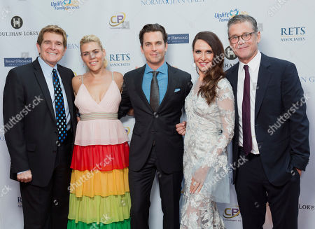 Darrell Evora, from left, Busy Philipps, Matt Bomer, Janie Bryant and Simon Halls arrive at the Uplift Family Services at Hollygrove's 6th annual Norma Jean Gala at the W Hollywood, in Los Angeles