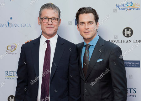 Matt Bomer, right, and Simon Halls arrive at the Uplift Family Services at Hollygrove's 6th annual Norma Jean Gala at the W Hollywood, in Los Angeles
