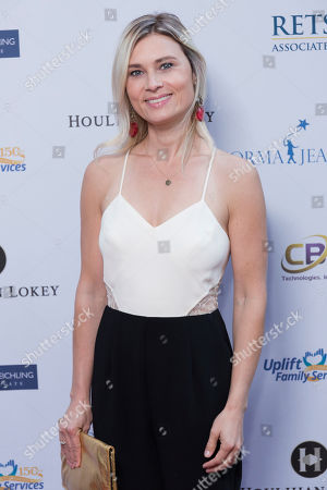 Kristina Klebe arrives at the Uplift Family Services at Hollygrove Gala at the W Hollywood, in Los Angeles