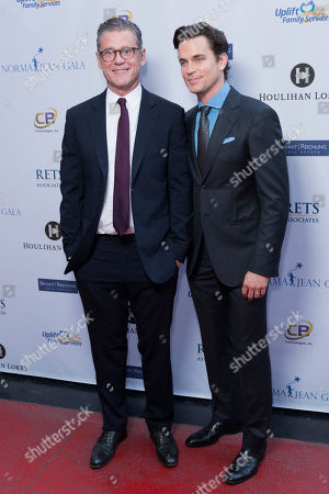 Matt Bomer, right, and Simon Halls arrive at the Uplift Family Services at Hollygrove Gala at the W Hollywood, in Los Angeles