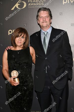 Stock Image of Sally Angel, left, and Andre Singer pose ith press room at the 75th Annual Peabody Awards Ceremony at Cipriani Wall Street, in New York