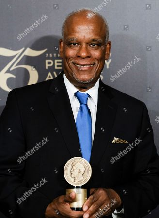 Stanley Nelson poses with his award at the 75th Annual Peabody Awards Ceremony at Cipriani Wall Street, in New York