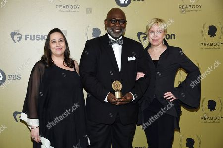 """Independent Lens: Trapped"""" Marilyn Ness, left, Dr. Willie Parker and Cindy Meehl pose in the press room at the 76th Annual Peabody Awards at Cipriani Wall Street, in New York"""
